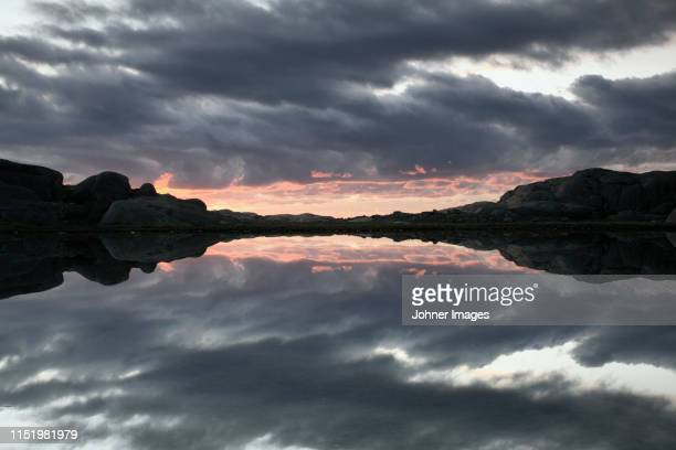 clouds reflecting in lake - archipelago stock pictures, royalty-free photos & images