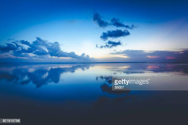 clouds reflecting in the ocean, bali island, indonesia - tranquility stock pictures, royalty-free photos & images