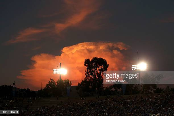 Clouds rise over the stadium at sunset during the game between the Nebraska Cornhuskers and the UCLA Bruins at the Rose Bowl on September 8 2012 in...