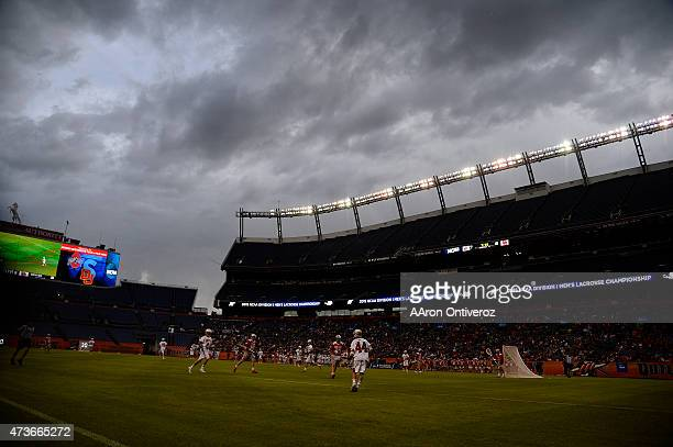 Clouds roll in as the Denver Pioneers and the Ohio State Buckeyes play during the second half of Denver's 15-13 NCAA tournament quarterfinal win. The...