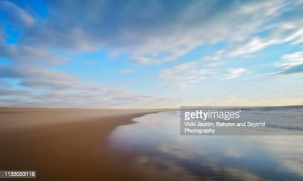 clouds, seascape, reflections and blue sky at morning on jones beach - jones beach stock pictures, royalty-free photos & images
