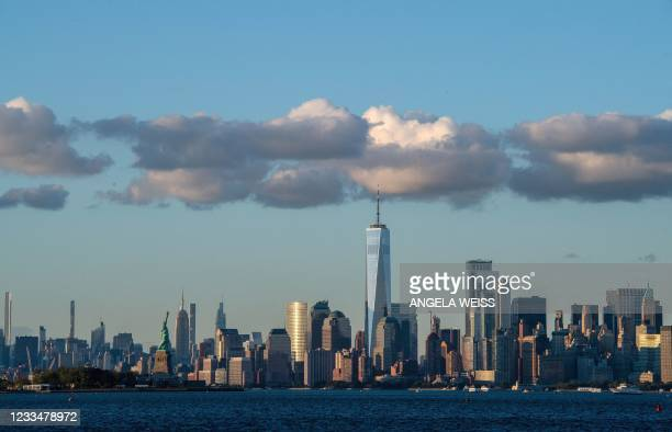 Clouds sit above the Manhattan skyline and Statue of Liberty on June 15, 2021 in New York City.