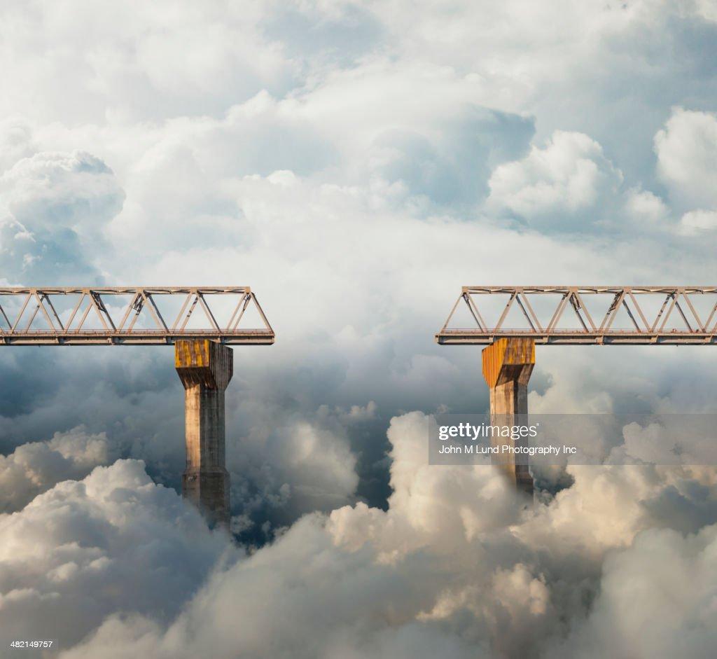 Clouds surrounding gap in bridge : Stock Photo