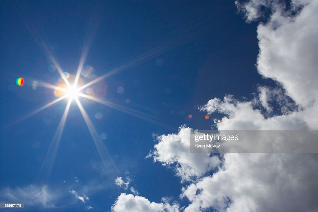 Clouds with flare : Stock Photo