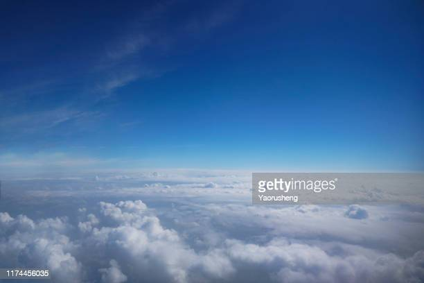 cloudscape and stratosphere shot out of an airplane window - atmosphere stock pictures, royalty-free photos & images
