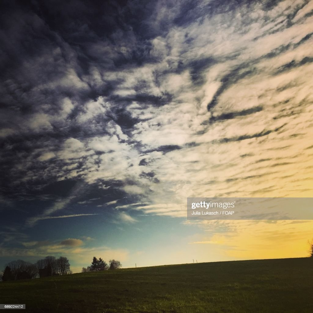 Cloudscape over field : Stock Photo