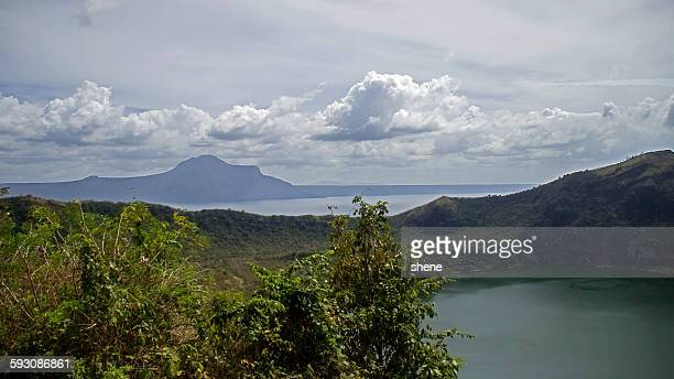 cloudscape over the crater taal, philippines - taal volcano stock photos and pictures