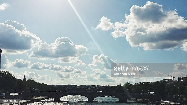 Cloudscape with bridge in Paris, France