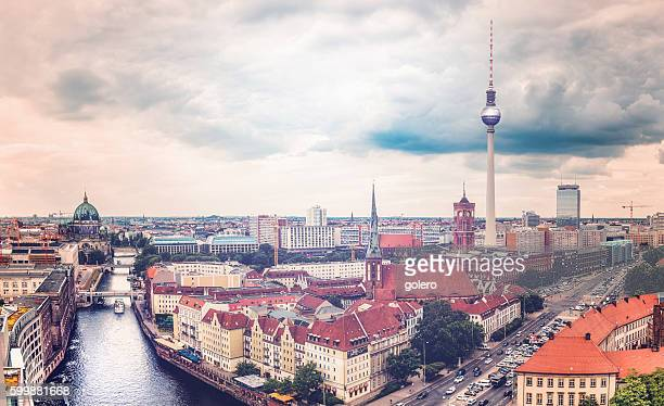 cloudy berlin cityscape with television tower and river view