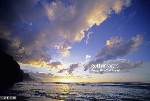 Cloudy blue sky over ocean at sunset, view from tropical beach.