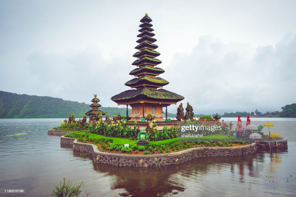 Cloudy but yet a beautiful view of Pura Ulun Danu Bratan, a Hindu temple on Bratan lake, Bali, Indonesia. : Stock Photo