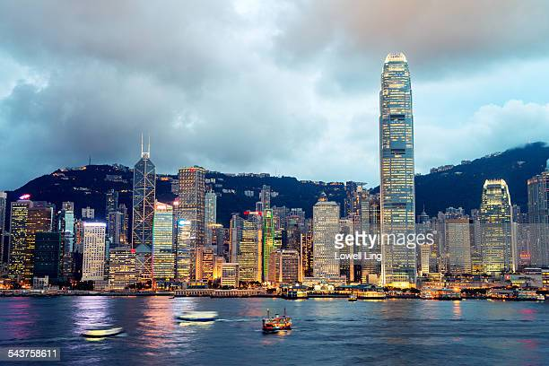 cloudy central, hong kong - victoria harbour hong kong stock pictures, royalty-free photos & images