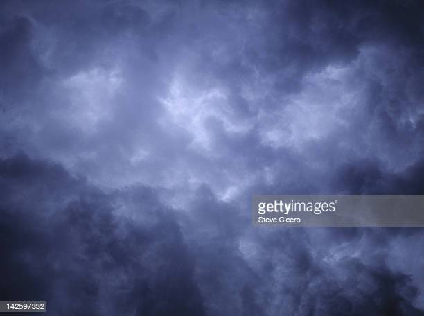 cloudy, dark skies - dark blue stock pictures, royalty-free photos & images