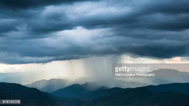 cloudy day in chiang mai - heavy rain stock photos and pictures