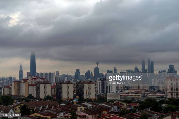 cloudy day over downtown kuala lumpur, malaysia. - shaifulzamri stock pictures, royalty-free photos & images