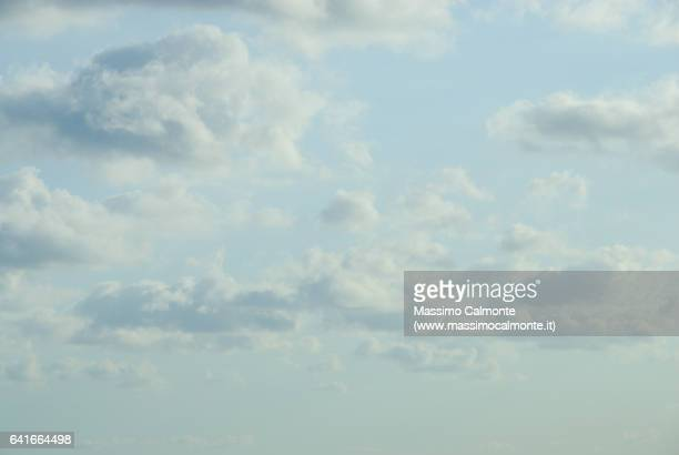 cloudy light blue sky - overcast stock pictures, royalty-free photos & images