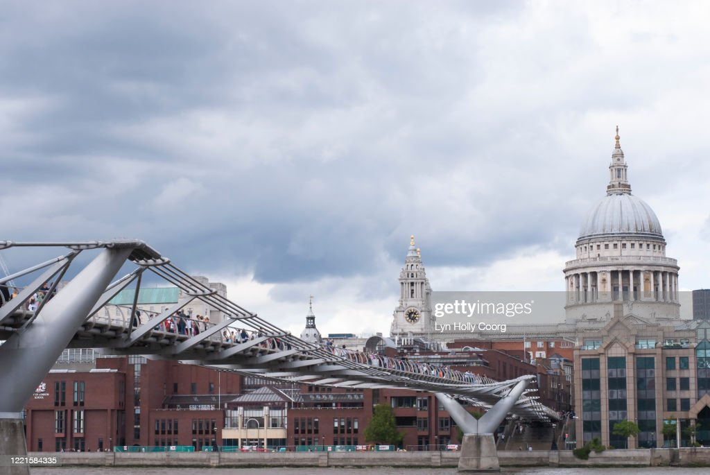 Cloudy London skyline with St Pauls Cathedral and the Millennium Bridge : Stock Photo