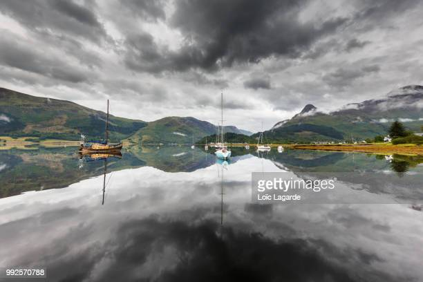 cloudy mirror on loch leven in ballachulish - lagarde stock pictures, royalty-free photos & images