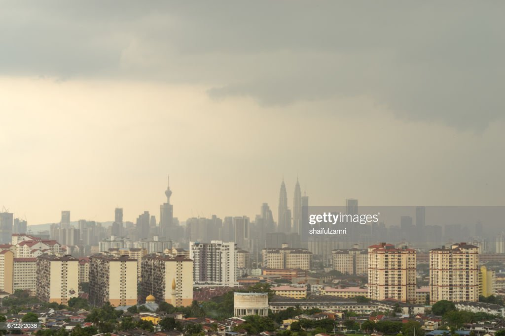 Cloudy moments of downtown Kuala Lumpur with Petronas Twin Towers and KL Tower dominant the skyline. : Stock Photo