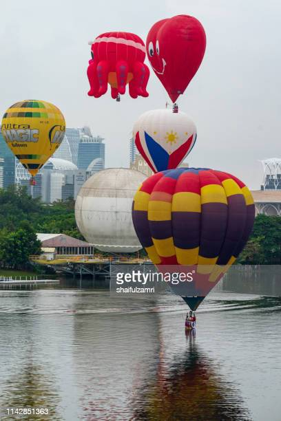 Cloudy morning view with hot balloons over lake Putrajaya, Malaysia.