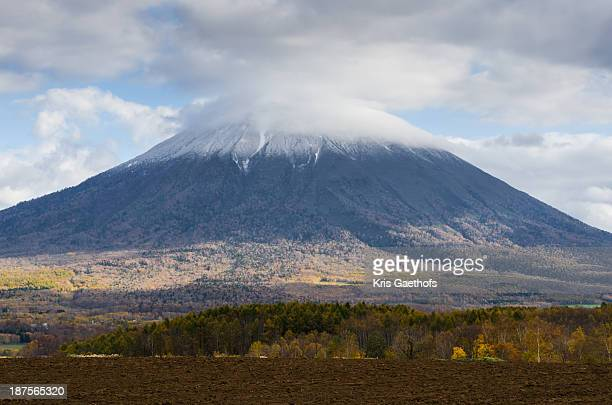 Cloudy Mt Yotei with light snow cover