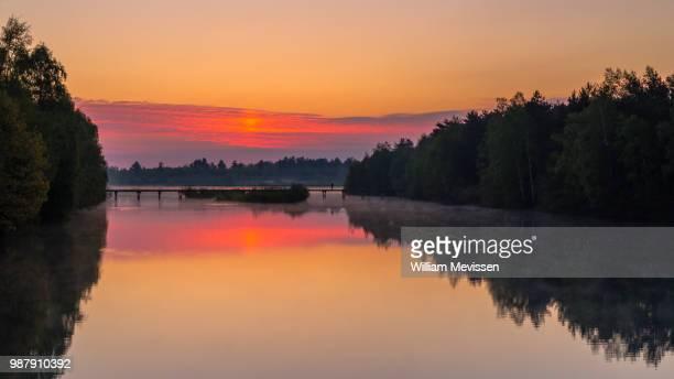 cloudy red sunrise - william mevissen stockfoto's en -beelden