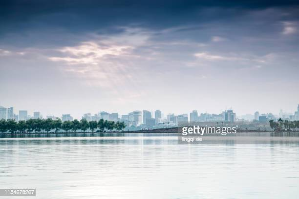 cloudy scenery of west lake in hangzhou, china - west lake hangzhou stock pictures, royalty-free photos & images