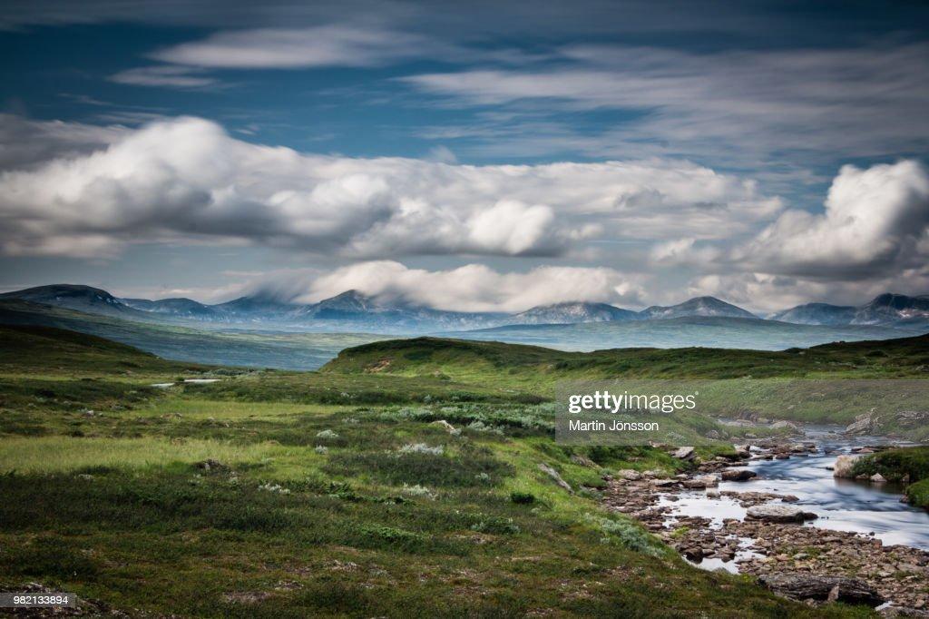 Cloudy sky above land, Jamtland, Sweden : Stock Photo