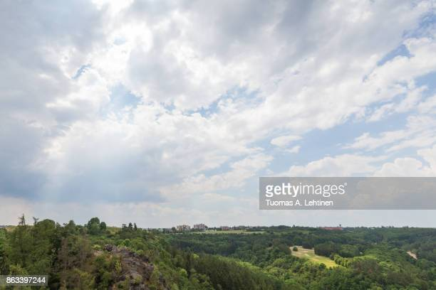Cloudy sky above lush Divoka Sarka. It's a nature reserve on the outskirts of Prague in Czech Republic. Copy space.