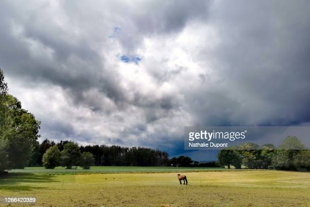 cloudy sky after the thunderstorm with a clearing in the countryside - charleroi stock pictures, royalty-free photos & images