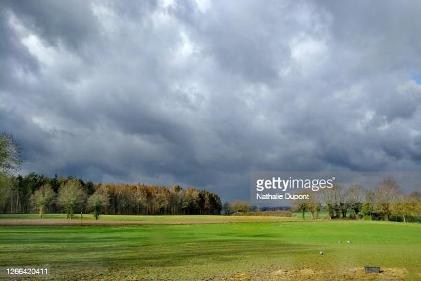 cloudy sky after the thunderstorm with a clearing in the countryside - belgium bildbanksfoton och bilder