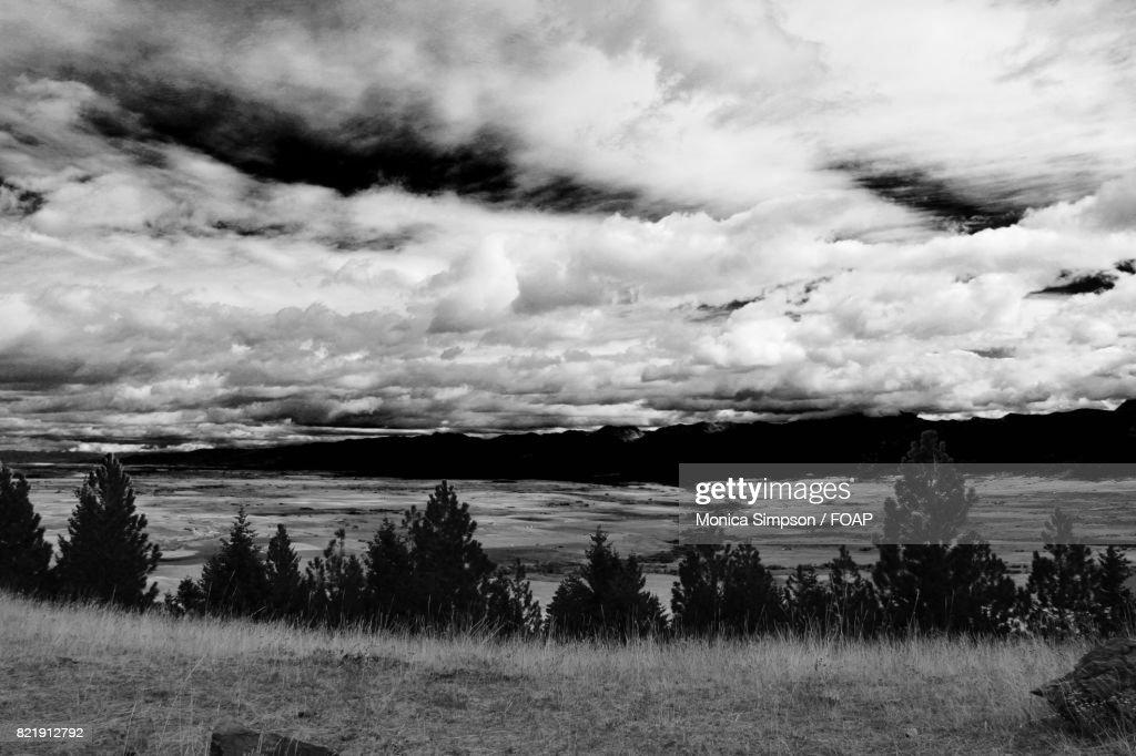 Cloudy sky against landscape : Stock Photo