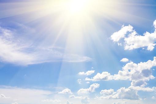 cloudy sky blue with sun 498459181