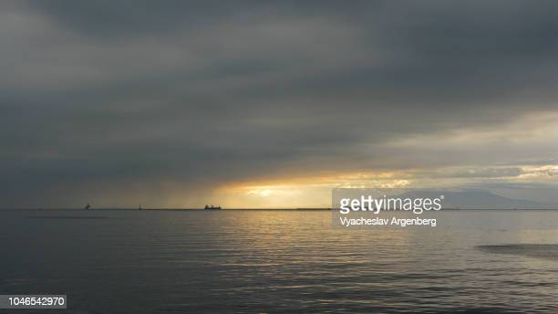 cloudy sky in manila bay, sunset time, philippines - argenberg stock pictures, royalty-free photos & images