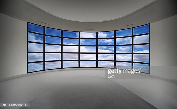 Cloudy sky on multiple television monitors