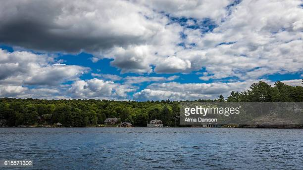 cloudy sky on muskoka lakes - alma danison fotografías e imágenes de stock
