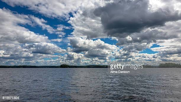 cloudy sky on muskoka lakes - alma danison stock photos and pictures