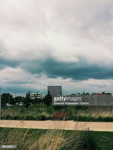 cloudy sky over city - detroit michigan stock pictures, royalty-free photos & images