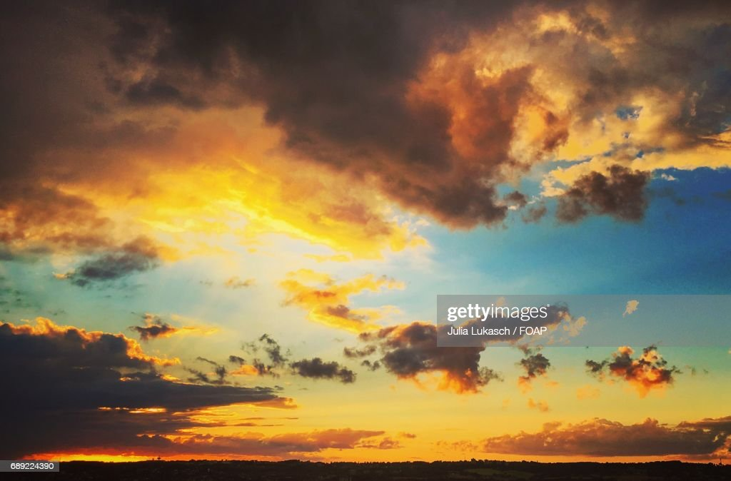 Cloudy sky over landscape during sunset : Stock Photo