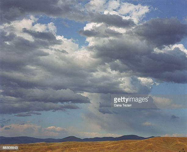 cloudy sky over montana landscape - dana barron stock photos and pictures