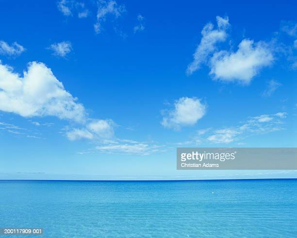 cloudy sky over ocean - clear sky stock pictures, royalty-free photos & images