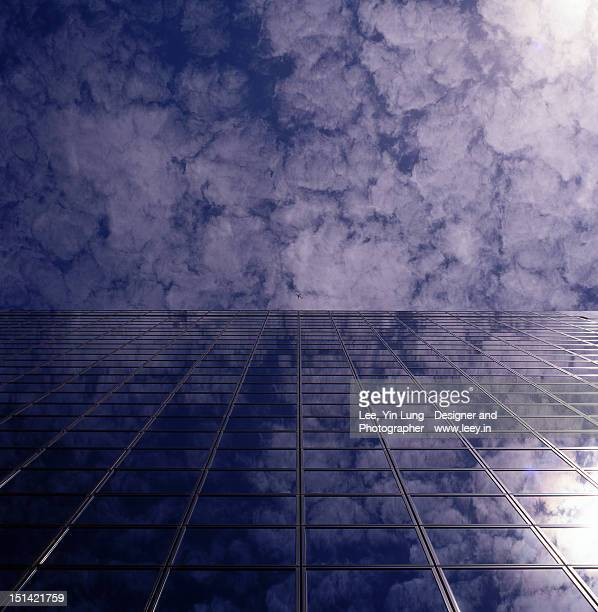 Cloudy Sky reflected on glass building