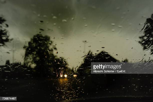 cloudy sky seen through wet windshield - albrecht schlotter stock photos and pictures