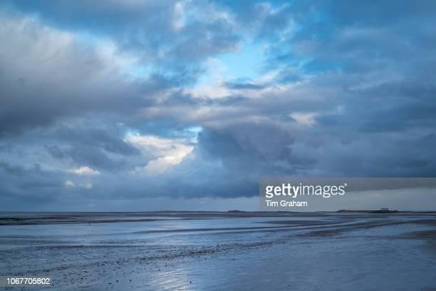 Cloudy skyscene and Norfolk coastal scene at Titchwell North Norfolk England UK
