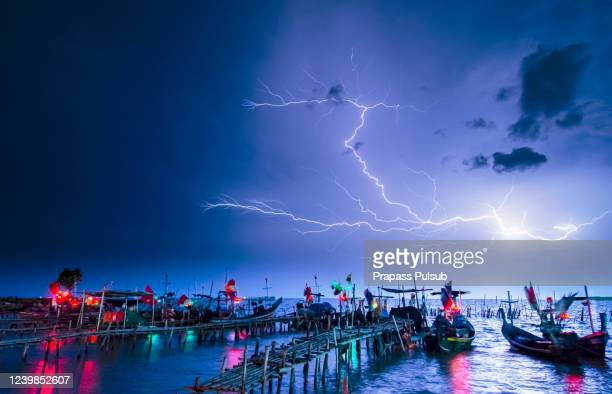 cloudy storm in the sea before rainy. tornado storms cloud above the sea. monsoon season. huge storm clouds with rain over sea , strong winds, heavy rain storm - tsunami stock pictures, royalty-free photos & images