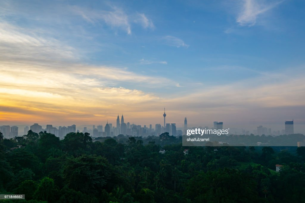 Cloudy sunrise over KL Tower and surrounded buildings in downtown Kuala Lumpur, Malaysia. : Stock Photo