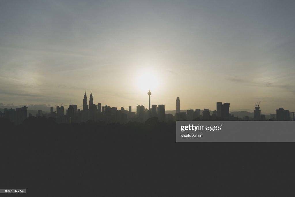 Cloudy sunrise over silhouette of downtown Kuala Lumpur, Malaysia. : Stock Photo