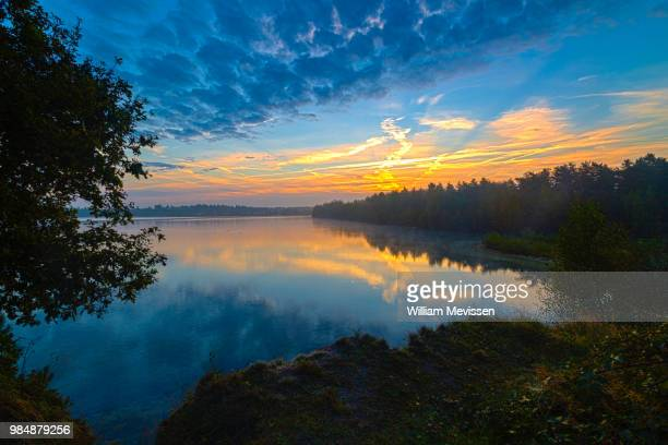 cloudy sunrise - william mevissen stock pictures, royalty-free photos & images