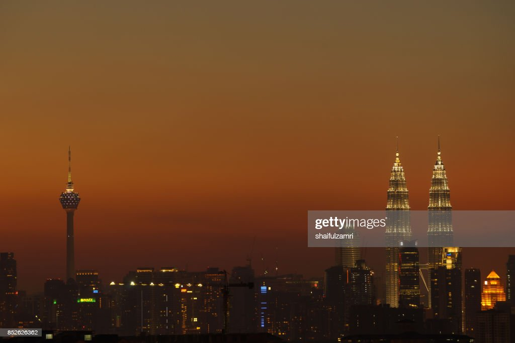 A cloudy sunset in Kuala Lumpur, the capital of Malaysia. Its modern skyline is dominated by the 451m tall KLCC, a pair of glass and steel clad skyscrapers. : Stock Photo