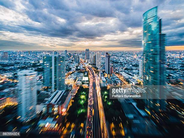 Cloudy Sunset over Bangkok Cityscape with zoom style